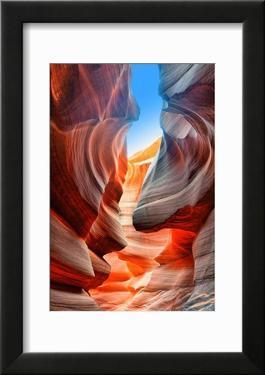 Sunlight Reflected off of the Red Rock Curves of the Antelope Canyon Slot Canyons in Page  Arizona.