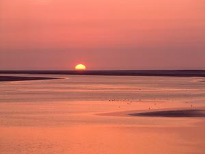 Sunrise at bay of Mont Saint-Michel, Brittany, France