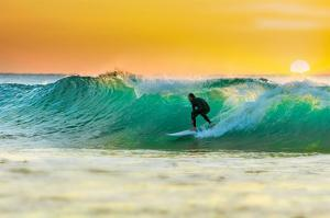 Sunrise Surfing Breeaking Wave