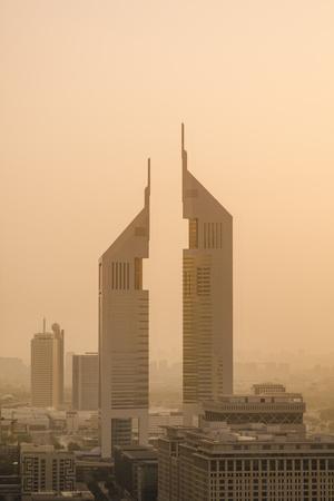 https://imgc.allpostersimages.com/img/posters/sunset-engulfs-the-jumeirah-emirates-towers-hotel-dubai-uae_u-L-PU3GEU0.jpg?p=0