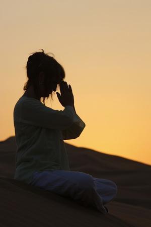 https://imgc.allpostersimages.com/img/posters/sunset-meditation-in-the-desert-abu-dhabi-united-arab-emirates_u-L-Q1GYHOA0.jpg?artPerspective=n