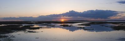 https://imgc.allpostersimages.com/img/posters/sunset-over-marshes-of-chichester-harbour-on-a-very-still-evening-west-sussex-england-uk-europe_u-L-PHCL1U0.jpg?p=0