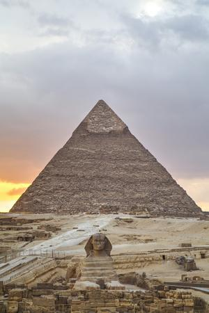 https://imgc.allpostersimages.com/img/posters/sunset-sphinx-in-foreground-and-the-pyramid-of-chephren-the-pyramids-of-giza_u-L-PXXXO90.jpg?artPerspective=n