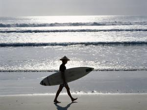 Sunset, Surfer Walking Along Beach, Kuta Beach, Bali, Indonesia