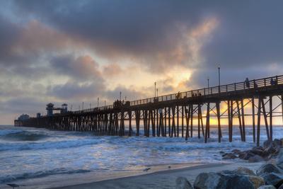 https://imgc.allpostersimages.com/img/posters/sunset-through-oceanside-pier_u-L-Q1AHKJF0.jpg?p=0