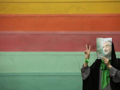 Supporter of Mir Hossein Mousavi Hides Her Face as She Waits at an Election Rally in Tehran