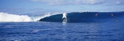 Surfers in the Sea, Tahiti, French Polynesia