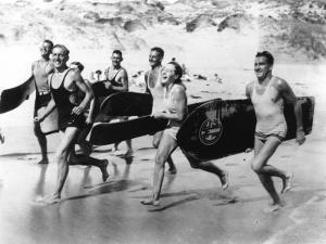 Surfers Running