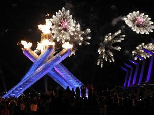 Surrounding the Olympic Flame as Fireworks Explode after the Opening Ceremony of 2010 Winter Games