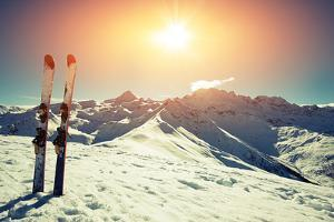 Skis in Snow at Mountains by svariophoto