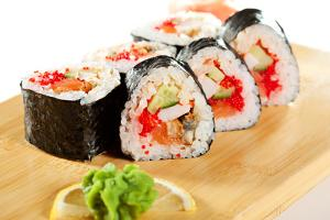 Japanese Cuisine - Sushi Roll with Salmon, Shrimps, Eel and Tobiko Inside. Nori Outside by svry