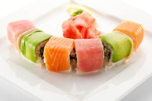 Rainbow Maki Sushi - Roll with Eel and Cream Cheese Inside. Tuna, Salmon and Avocado Outside by svry