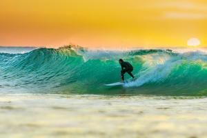 Sunrise Surfing by sw_photo