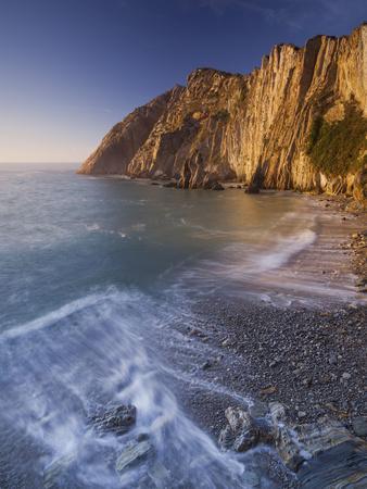https://imgc.allpostersimages.com/img/posters/swell-at-the-playa-del-silencio-costa-verde-asturias-spain_u-L-Q11YRZN0.jpg?p=0