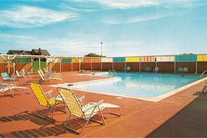 Swimming Pool with Deck Chairs