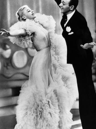https://imgc.allpostersimages.com/img/posters/swing-time-ginger-rogers-fred-astaire-1936_u-L-PH51KE0.jpg?artPerspective=n