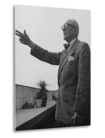 Swiss-Born Architect Le Corbusier Standing on Terrace and Pointing Out Something in Distance