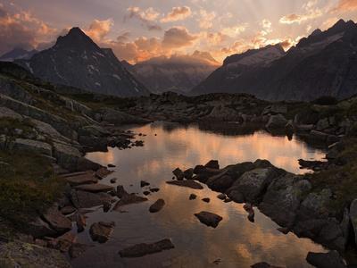 https://imgc.allpostersimages.com/img/posters/switzerland-the-bernese-oberland-lauteraarhorn-mountain_u-L-Q11YGC50.jpg?p=0