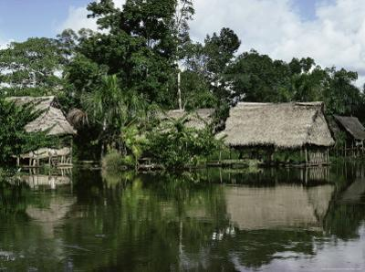 Building on Stilts Reflected in the River Amazon, Peru, South America