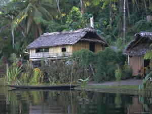 Houses and Boat, Sepik River, Papua New Guinea by Sybil Sassoon