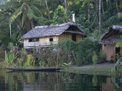 Houses and Boat, Sepik River, Papua New Guinea