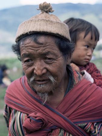 Old Man Carrying Child, Bhutan