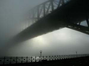 Sydney Harbor Bridge is Covered by a Thick Vail of Fog in the Early Hours of the Morning