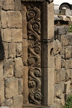 https://imgc.allpostersimages.com/img/posters/syria-as-suwayda-ruins-of-city-gate-detail-of-architecture_u-L-POPOYX0.jpg?p=0