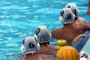 Water Polo Players Resting in a Swimming Pool by tanyast77