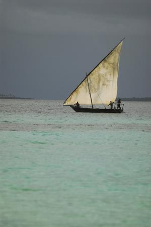 https://imgc.allpostersimages.com/img/posters/tanzania-zanzibar-nungwi-traditional-sailing-boat-with-storm_u-L-PU3H8D0.jpg?p=0