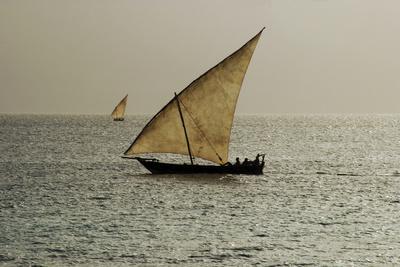 https://imgc.allpostersimages.com/img/posters/tanzania-zanzibar-nungwi-traditional-sailing-boat-with-storm_u-L-PU3H8S0.jpg?p=0