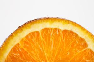 Fresh Orange Slice on White by Tarick Foteh