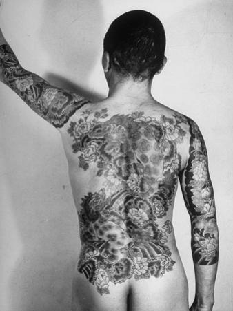 Tattoo Design of Peonies and Dragon on Back of Japanese Gambler