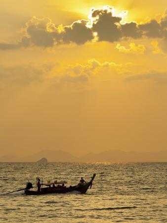 https://imgc.allpostersimages.com/img/posters/taxi-boat-in-the-phra-nang-beach-evening-mood-ao-nang-krabi-thailand_u-L-Q11YHTG0.jpg?artPerspective=n