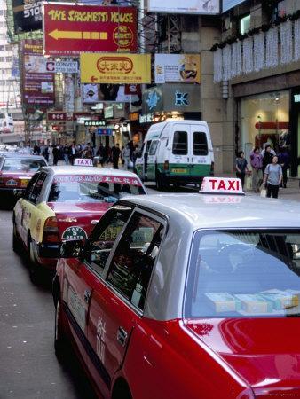 https://imgc.allpostersimages.com/img/posters/taxis-causeway-bay-hong-kong-island-hong-kong-china_u-L-P1K1550.jpg?p=0