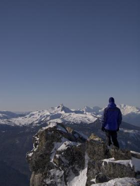 A Man Admires the View Over the Canadian Rockies by Taylor S. Kennedy