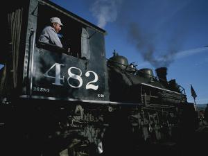 A Steam Engine Engineer Looks Out the Window of the Engine by Taylor S. Kennedy