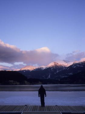 A Woman Watches Alpenglow Touch the Mountaintops at Sunset, Whistler, British Columbia, Canada by Taylor S. Kennedy