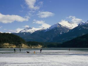 Hockey on Frozen Green Lake in Whistler, British Columbia, Canada by Taylor S. Kennedy