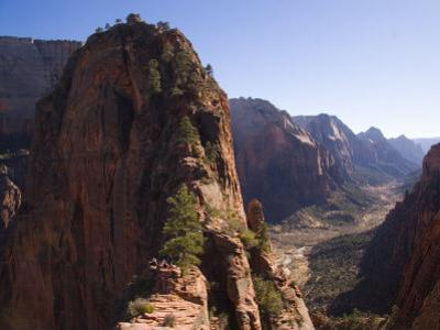 Picnickers Eat on a Narrow Ledge Over the Valley, Zion National Park, Utah