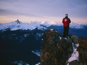 Ski Patrol Enjoys the Early Morning View of Mountain Alpenglow by Taylor S. Kennedy