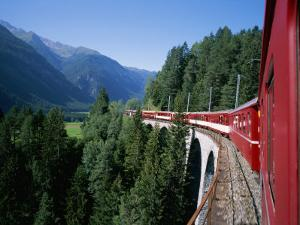 The Glacier Express Crosses a Bridge in Switzerland by Taylor S. Kennedy