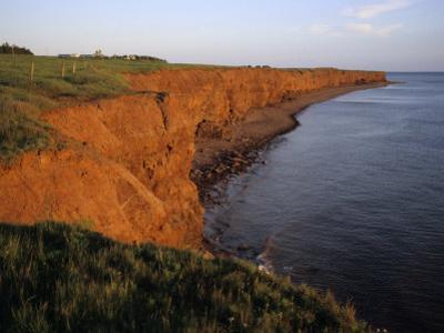 The Red Cliffs of Prince Edward Island at Sunset Glow, Prince Edward Island, Canada by Taylor S. Kennedy
