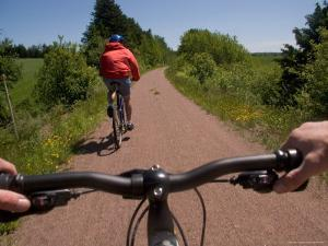 Two Bikers Enjoy a Summer Ride Along a Trail, Charlottetown, Prince Edward Island, Canada by Taylor S. Kennedy