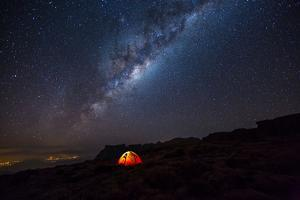 Camping under the Stars. the Milky Way Stretches Overhead the Tent High above the Villages in the D by TCS Photography