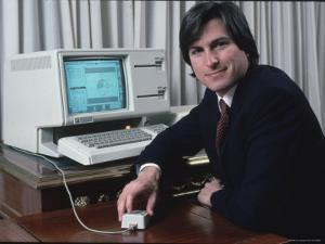 Apple Computer Chairman Steve Jobs with New Lisa Computer During Press Preview by Ted Thai