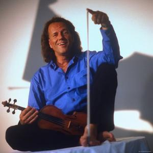 Dutch Violinist Andre Rieu Relaxing, Taking Practice Break with Violin by Ted Thai