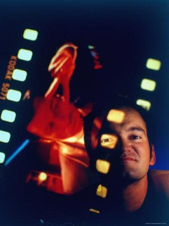 "Film Director Quentin Tarantino Framed by Projected Clip From His Movie ""Pulp Fiction"""
