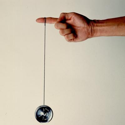 Hand Holding String Attached to Tom Khun Yo-Yos Ltd's High-Tech, Aluminum, Ball Bearing Yo-Yo