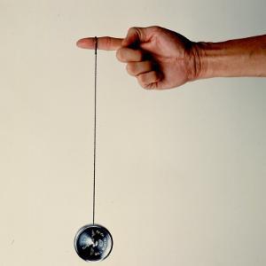 Hand Holding String Attached to Tom Khun Yo-Yos Ltd's High-Tech, Aluminum, Ball Bearing Yo-Yo by Ted Thai